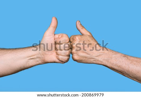 Partnership. Thumbs up sign isolated on blue - stock photo
