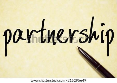 partnership word write on paper  - stock photo
