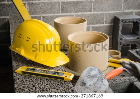 Parts and tools for the construction of modular ceramic chimney in the house, close-up  - stock photo