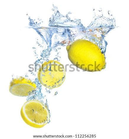 Parts and whole lemon under water. Healthy and tasty food