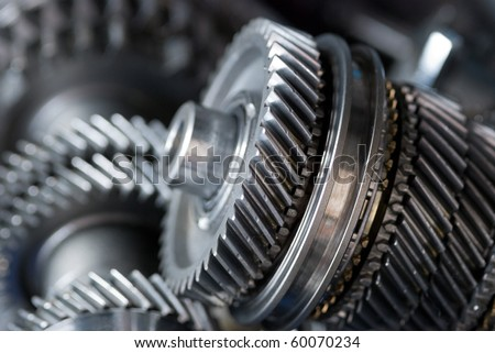 Parts from a vehicle gearbox. Shallow depth of field with the nearest gear in focus. - stock photo