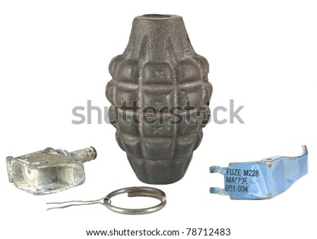 Parts of a disassembled hand grenade isolated on a white background