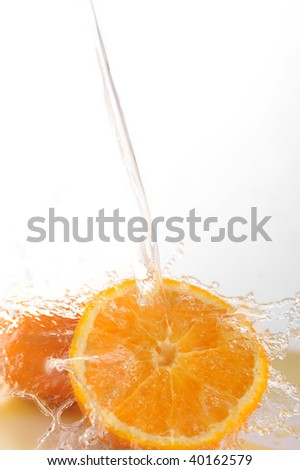 Parts of bright oranges and water splashes