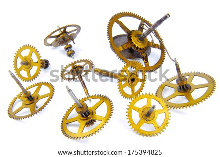 parts of clockwork isolated on white - stock photo