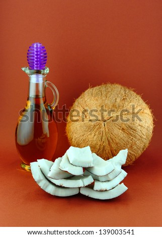 Parts of coconut and natural coconut walnut oil . - stock photo