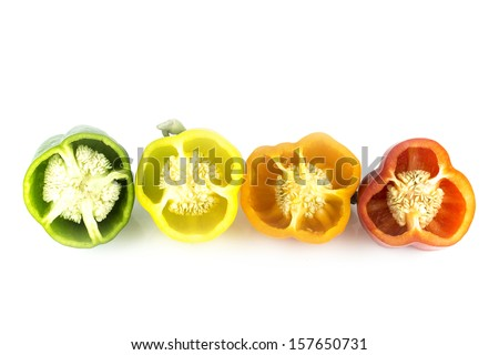 Parts of colorful sweet bell pepper on white background. - stock photo