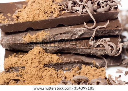 Parts of dark chocolate on the table