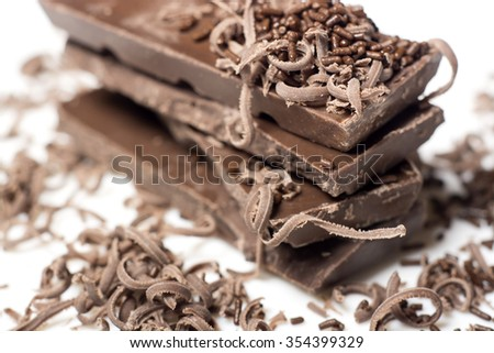 Parts of dark chocolate on the table - stock photo