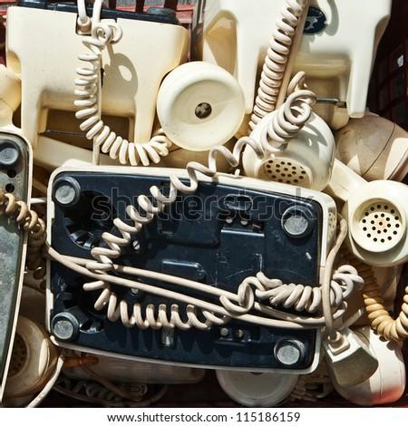 Parts of retro telephones on a flea-market table - stock photo