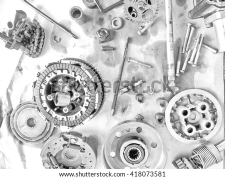 Parts of the engine has been placed on a gray background. / Use natural light indoors./ A black and white