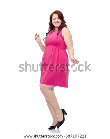 party and people concept - smiling happy young plus size woman posing in pink dress dancing