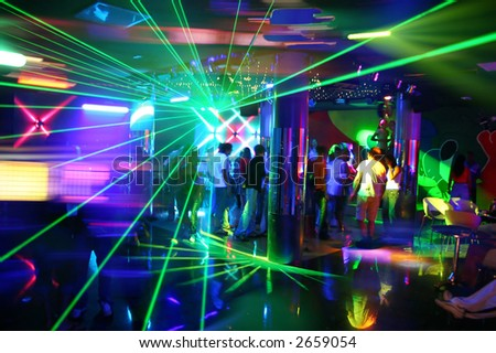 Party at Disco with young people and fantastic laser show - stock photo