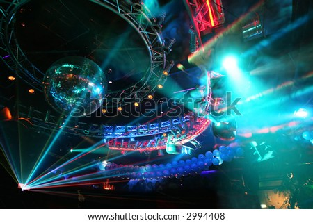 Party at Large Disco with special effects and fantastic laser show in smoke - stock photo