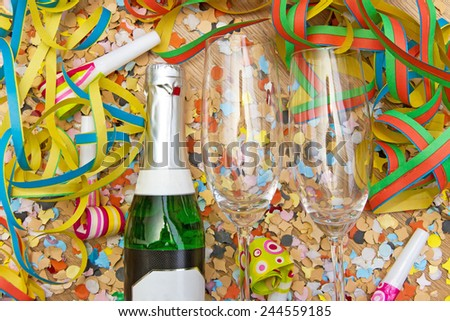 Party background with confetti, steamer and champagne - stock photo