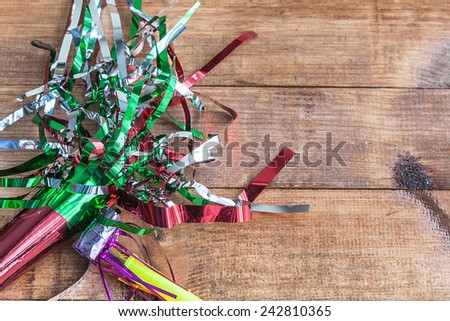 Party carnival items on white wooden table - stock photo