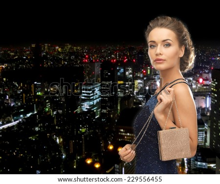 party, celebration, holiday and people concept - beautiful woman in evening dress with small bag - stock photo