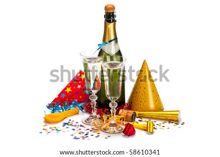 Party - champagne, caps, confetti and streamers - stock photo
