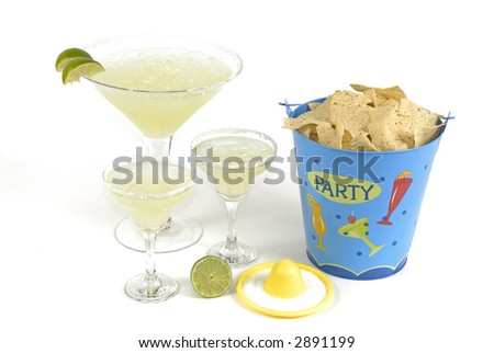 Party chips and three margaritas. - stock photo