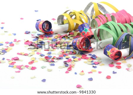 party concepts  paper confetti with streamers and four party blowers on white background - stock photo