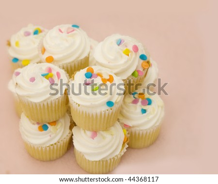 Party cupcakes on pink background