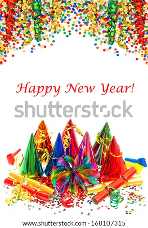 party decoration. garlands, streamer, carnival hats and confetti on white. festive background with sample text Happy New Year! - stock photo