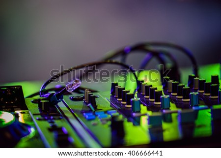 Party DJ. Audio mixer during a night party. - stock photo