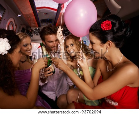 Party fun with champagne in limousine.?