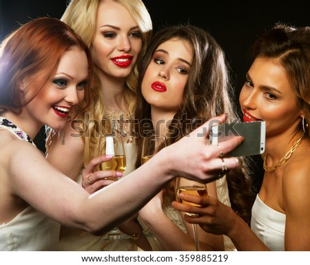 party  girls clinking flutes with sparkling wine