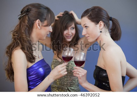 party girls dancing and drinking at disco - shot in studio - stock photo
