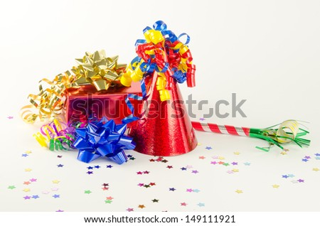 Party hat, present and favor with bright ribbons. - stock photo