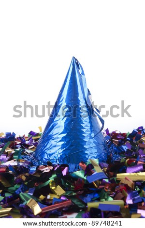 Party hat with confetti isolated on white - stock photo