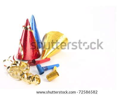 Party hats, blower and streamers isolated on white - stock photo