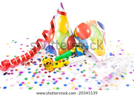 Party hats, horns or whistles and confettis on white background. - stock photo
