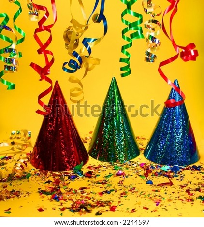 Party hats on a yellow background - stock photo