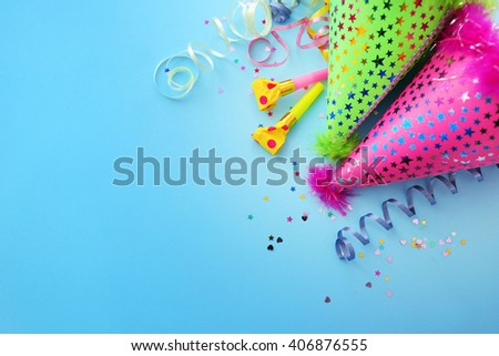 Party hats on blue background - stock photo