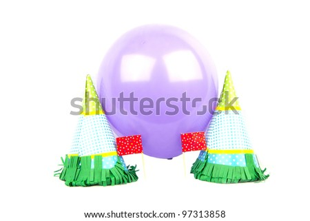 Party hats with balloon isolated in white - stock photo