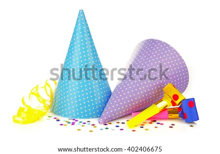 Party hats with blowers, isolated on white - stock photo