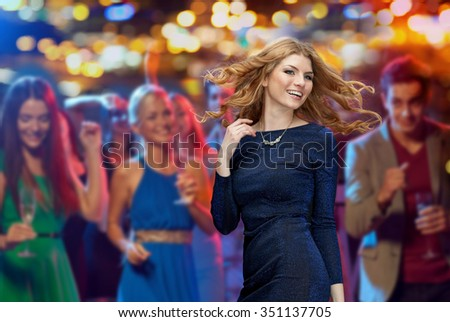 party, holidays, nightlife and people concept - happy young redhead woman dancing at night club disco over night lights background - stock photo