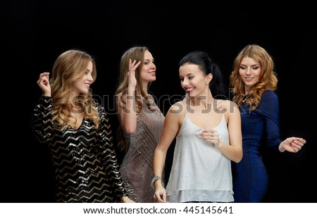 party, holidays, nightlife and people concept - happy young women dancing at night club disco over black background - stock photo