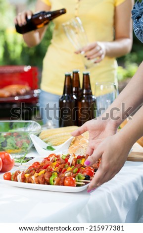 Party in a garden with barbecue, vertical - stock photo