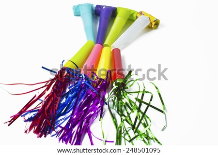 Party items, blowers and colorful streamer  - stock photo