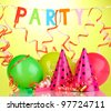 Party items on green background - stock photo