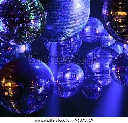 Party lights disco ball at nightclub - stock photo