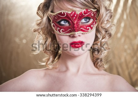 Party.Masquerade. Beautiful Girl in a Carnival mask over Holiday  - stock photo