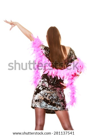 Party new year celebration and carnival concept. Elegant woman in evening sequin dress pink feather boa dancing isolated on white background. - stock photo