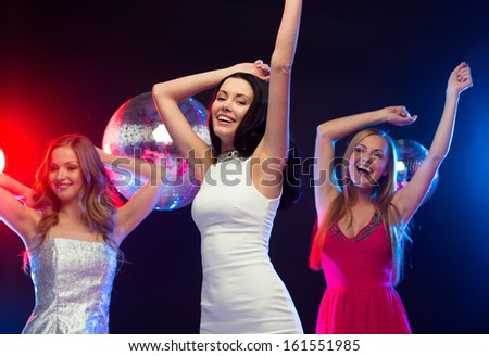 "party, ""new year"", celebration, friends, bachelorette party, birthday concept - three beautiful women in evening dresses dancing in the club - stock photo"