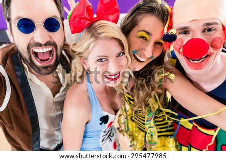 Party people celebrating carnival or new years eve - stock photo