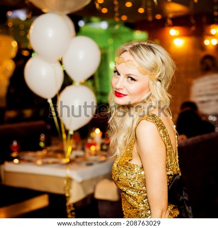 Party people concept. Emotive portrait of happy and young woman in restaurant. Stylish clothing and perfect hair. Indoor shot - stock photo