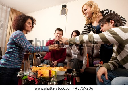 Party people having some drinks together, celebrating, having fun - stock photo