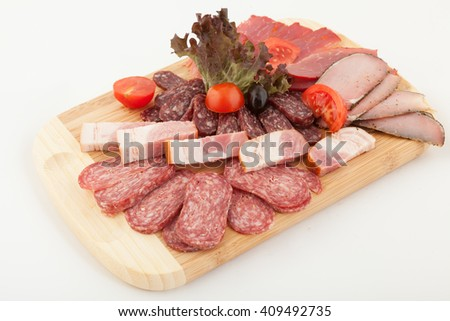 Party plate of salami, meat delicatessen - stock photo
